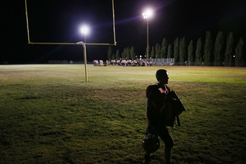 Tonopah player Alex Katzenback walks off the field following a high school football game between Sierra Lutheran and Tonopah in Tonopah, Nevada Friday August 28, 2015. Tonopah beat the team from Carson City, Nevada 55-26. (Andy Jacobsohn/The Dallas Morning News)