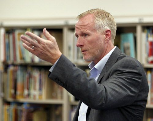 Garland ISD superintendent Bob Morrison talks with faculty during a school visit at Herfurth Elementary School in Rowlett on May 17, 2013.