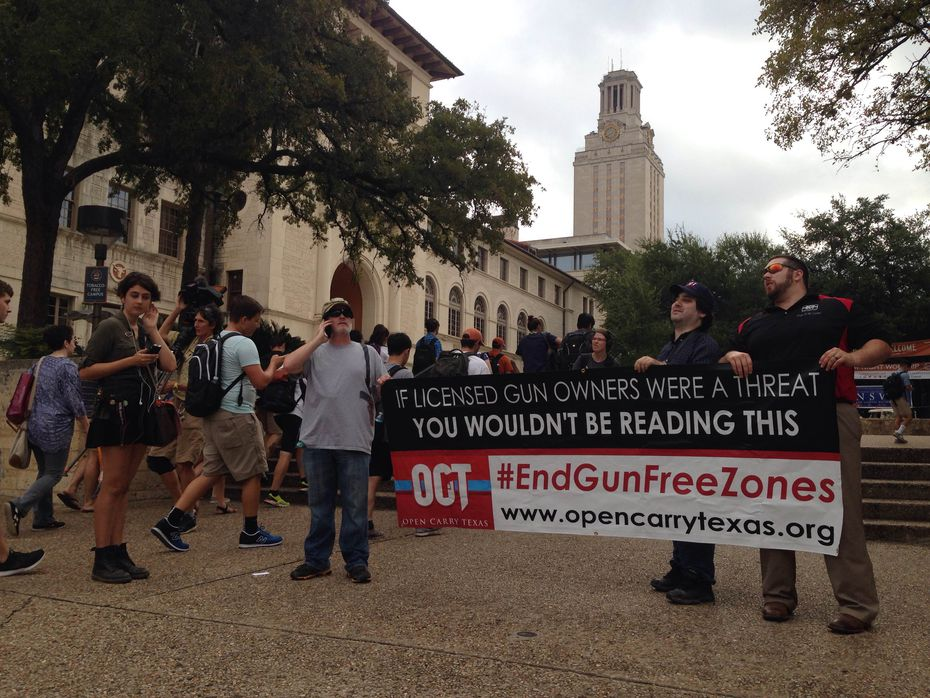 Gun-rights advocates from Open Carry Texas, including leader C.J. Grisham (left), were in the minority at Wednesday's protest at UT.