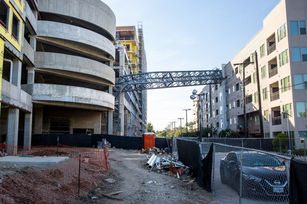 A construction crane remained embedded in the Dallas apartment complex for months before crews disassembled and removed it.