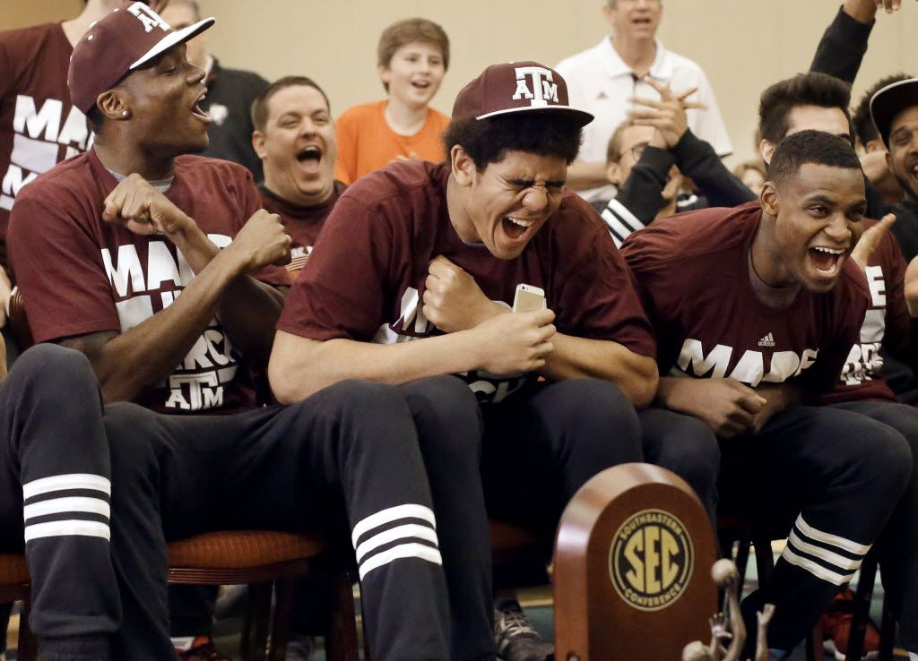 Texas A&M's Tyler Davis, center, cheers as his team's selection is announced in the NCAA college basketball tournament Sunday, March 13, 2016, in Nashville, Tenn. Texas A&M was selected as the third seed in the West Regional in Oklahoma City and will play Green Bay. (AP Photo/Mark Humphrey)