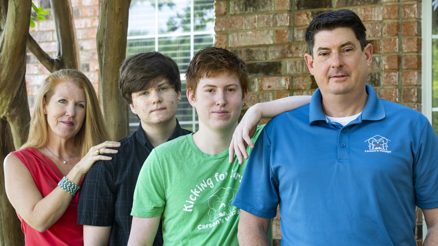 Jason Dyke and wife April at their Coppell home with their sons Ryan (left), a 16-year-old high school junior, and Alex, an 18-year-old senior. Their third son, 11-year-old Carson, died by suicide on April 28, 2017.