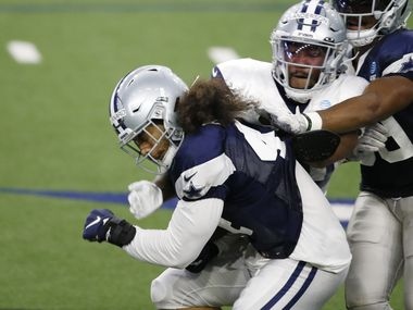 Cowboys linebacker Francis Bernard (44) is tackled by running back Darius Anderson (40) after intercepting a pass during training camp at The Star in Frisco on Tuesday, Aug. 18, 2020.