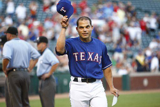 "ORG XMIT: *S1978786A* (Taken 08-18-09) --- Texas Rangers catcher Ivan ""Pudge"" Rodriguez (7) tips his hat to the Rangers fans, after taking out the team's lineup out to the umpires before the start of MLB baseball action between the Minnesota Twins and the Texas Rangers at the Rangers Ballpark in Arlington on Tuesday, August 18, 2009. (John F. Rhodes / The Dallas Morning ) 08192009xNEWS 08192009xBRIEFING"