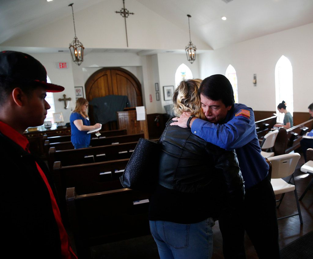 Rigoberto Serrano (from left) and Tetiana Aulova are greeted by David Timothy, also know as SoupMan, before service at SoupMobile Church for the homeless in Dallas on Feb. 4, 2018.