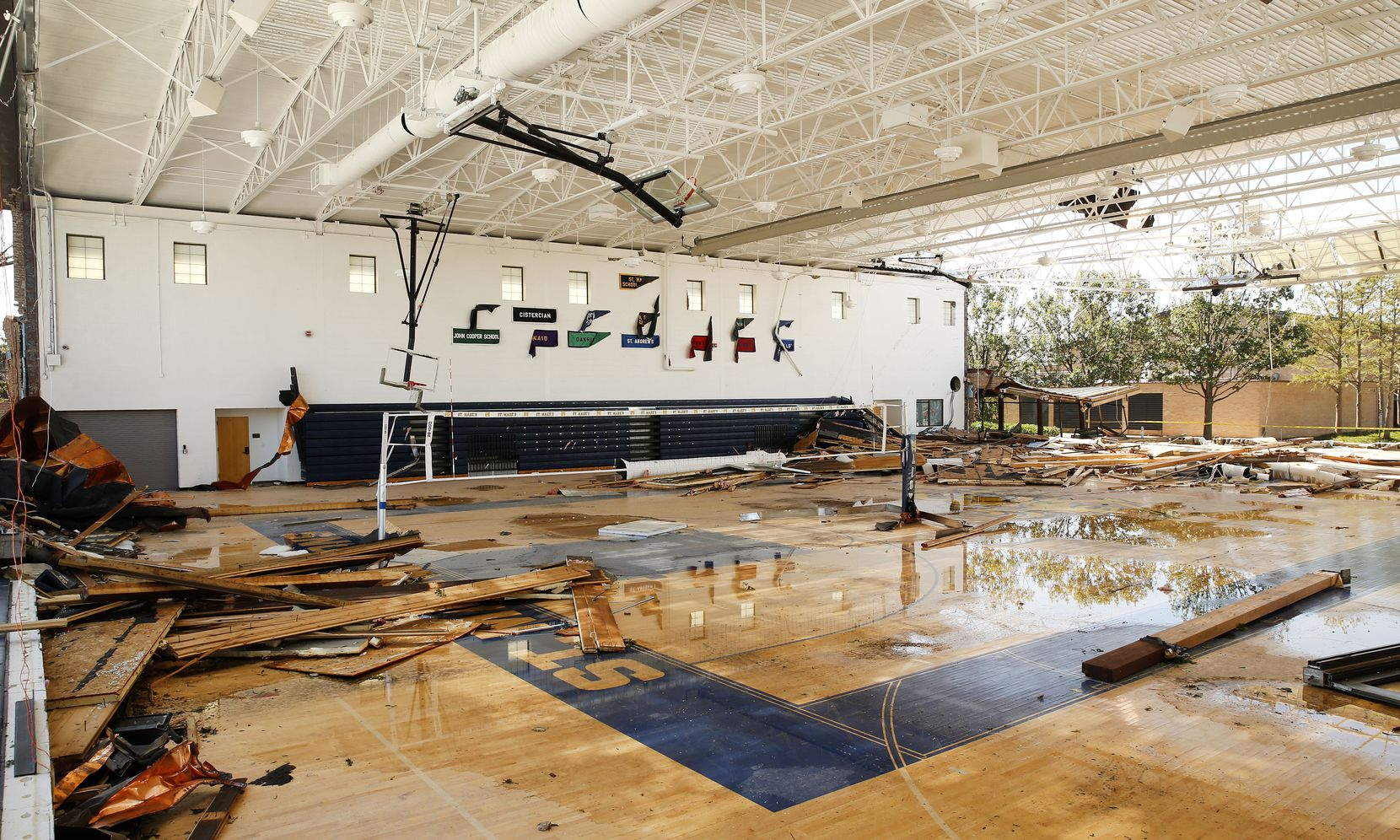 The gymnasium walls at St. Mark's School of Texas were blown over during the tornado in Dallas, Monday, October 21, 2019. A tornado tore through the entire neighborhood knocking down trees and ripping roofs from homes. (Tom Fox/The Dallas Morning News)