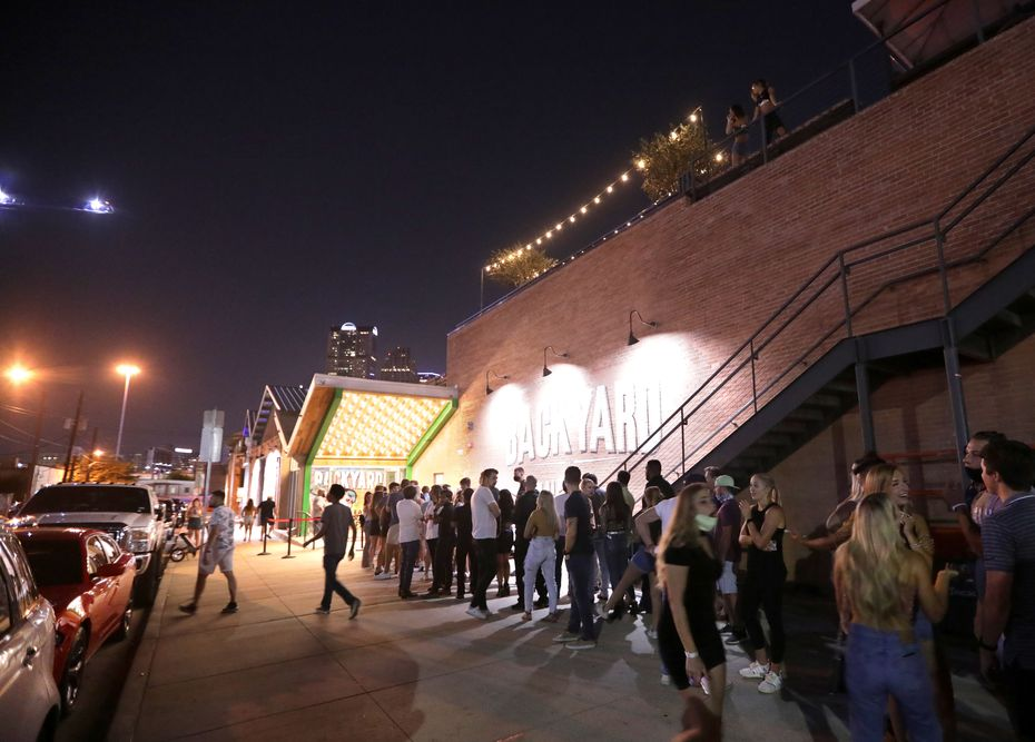 People gather outside Bottled Blonde's Backyard entrance in Deep Ellum on Aug. 28, 2020.