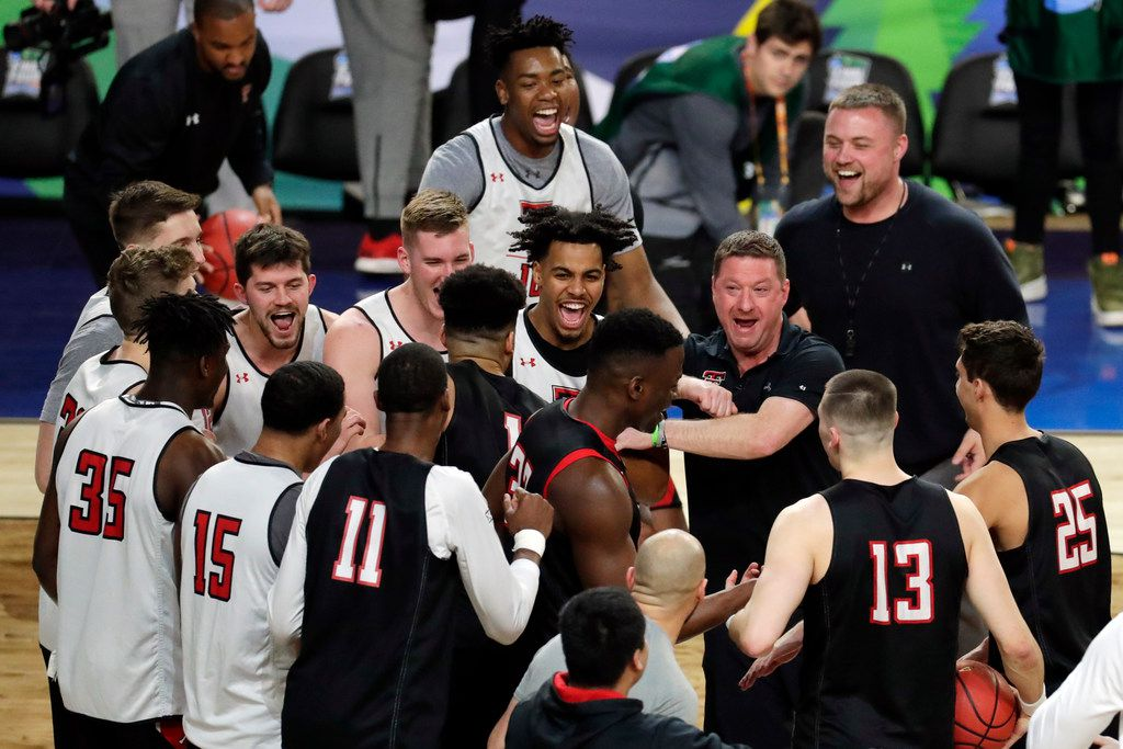 Texas Tech head coach Chris Beard laughs with his players in a huddle during a practice session for the semifinals of the Final Four NCAA college basketball tournament, Friday, April 5, 2019, in Minneapolis. (AP Photo/Matt York)
