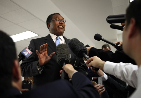 Dwaine Caraway, then acting mayor, spoke to reporters in 2011 after a judge denied his request to block the city from releasing records about a disturbance at his home.  Caraway was later convicted of accepting hundreds of thousands of dollars in bribes as a council member.