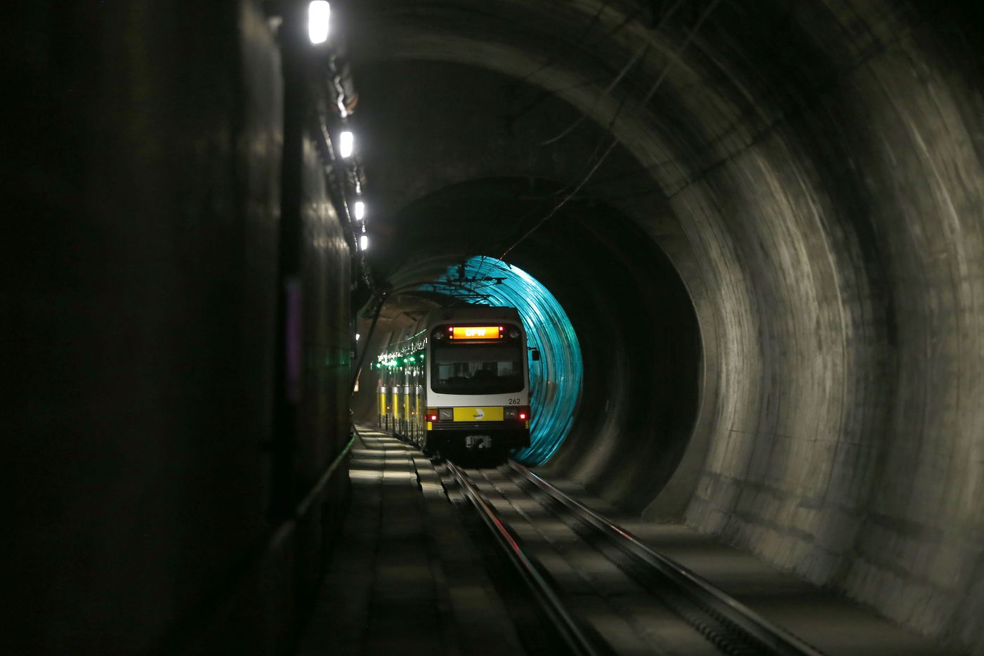 A DART train bound for Dallas-Fort Worth International Airport passes through a tunnel near the unfinished Knox Street station 80 feet below Central Expressway.