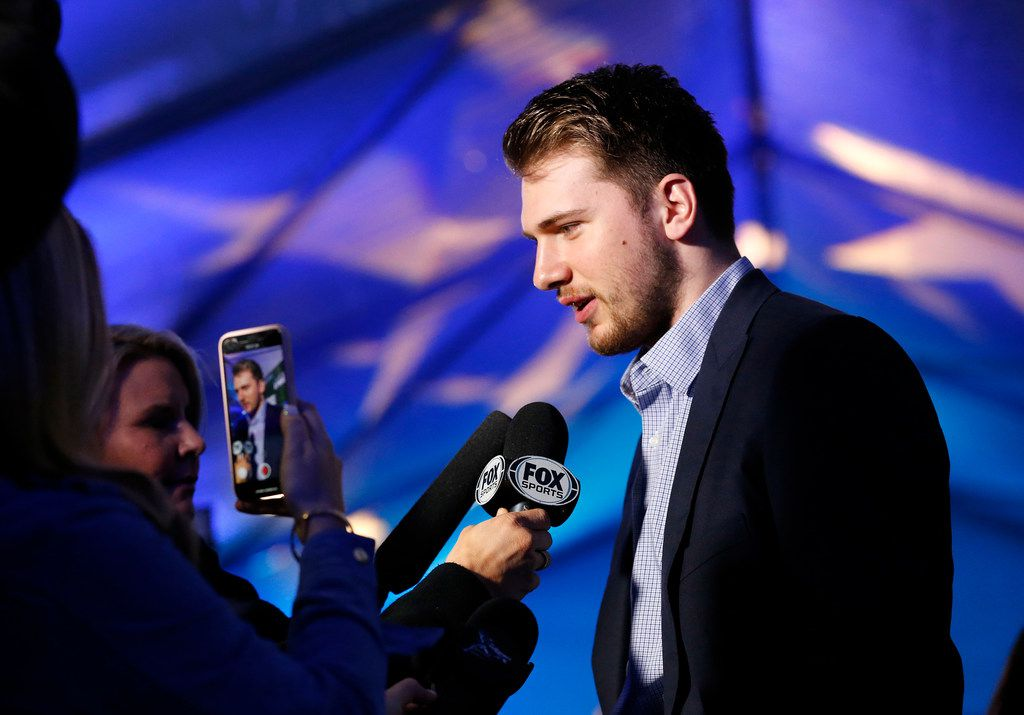 "Dallas Mavericks forward Luka Doncic visits with the media as he arrives on the ""blue carpet"" for the Mavs Ball at the American Airlines Center in Dallas, Friday, March 1, 2019. The 4th annual Ball is the Dallas Mavericks annual charity fund-raiser."