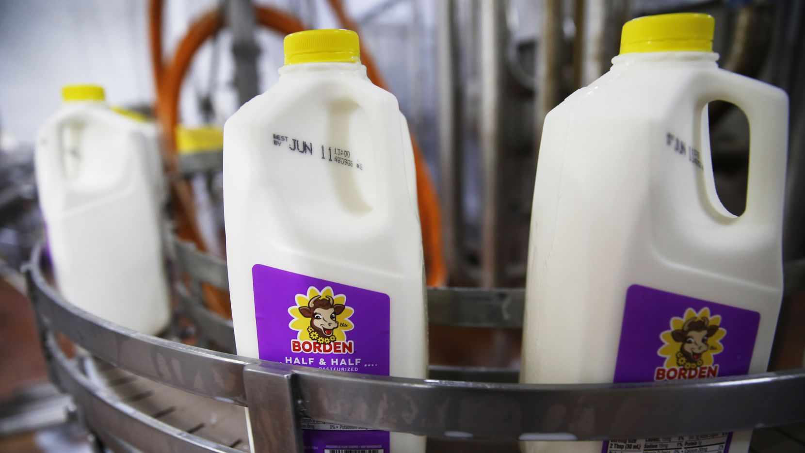 Bottles of half & half make their way through the bottling line at Borden Dairy Co. in Dallas.