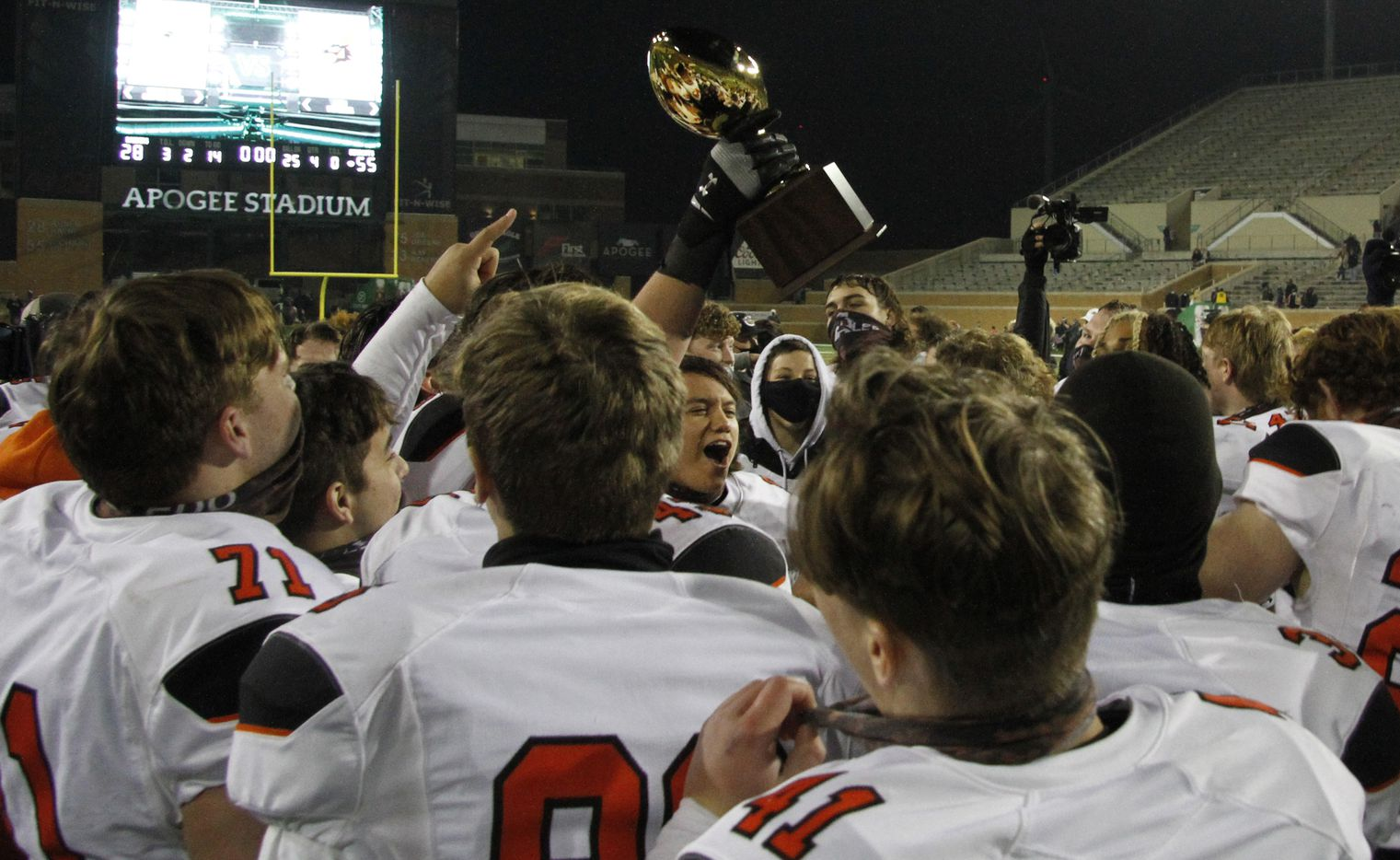 Aledo Bearcats players celebrate with the Class 5A Division ll championship trophy presented following their 55-28 victory over Wichita Falls Rider to advance to the state tournament. The two teams played their Class 5A Division ll state semifinal football playoff game at Apogee Stadium in Denton on January 8, 2021. (Steve Hamm/ Special Contributor)