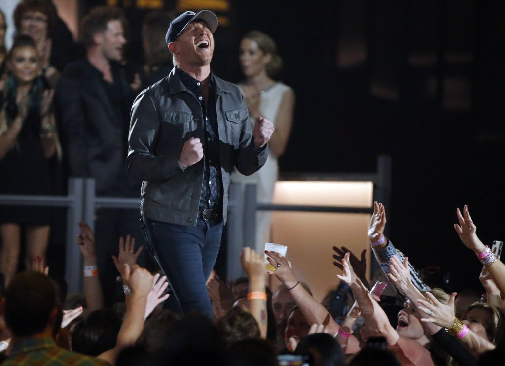 Cole Swindell celebrates after winning the best new artist award during the 2015 Academy of Country Music Awards Sunday, April 19, 2015 at AT&T Stadium in Arlington, Texas.