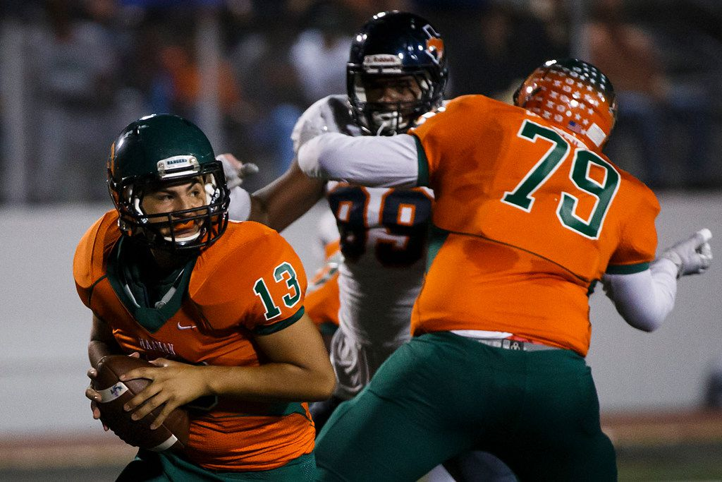 Naaman Forest quarterback Thomas Gutierrez (13) gets a block from Roger Davis-Jahnel (79) as he avoids the rush from Sachse defensive end Tyler Lacy (99) during the first half of a District 11-6A high school football game at Williams Stadium on Thursday, Nov. 2, 2017, in Garland, Texas. (Smiley N. Pool/The Dallas Morning News)
