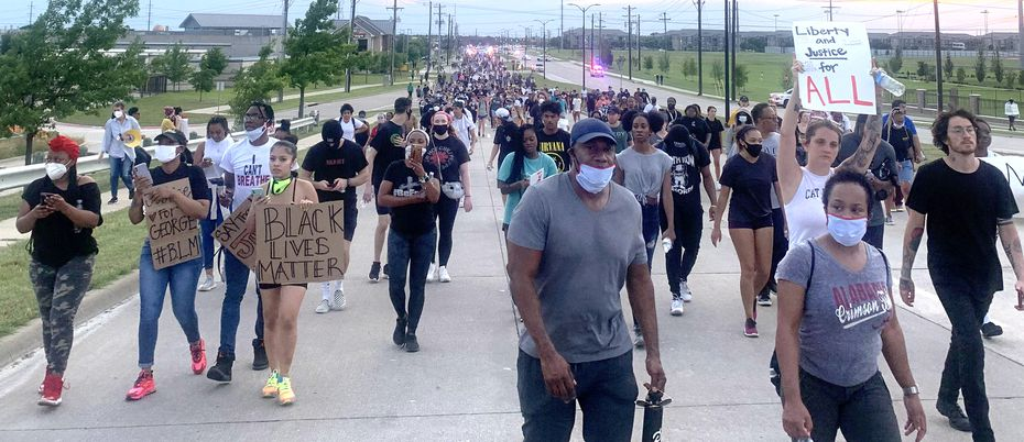 Black Lives Matter protesters march on Eldorado Pwy in Frisco on Monday evening, June 1, 2020.