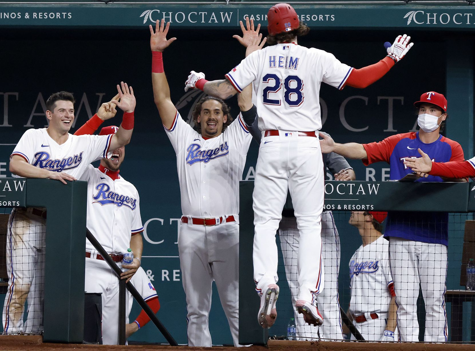 Texas Rangers Jonah Heim (28) is congratulated by teammates after hitting his first Major League home run during sixth inning against the Toronto Blue Jays at Globe Life Field in Arlington, Tuesday, April 7, 2021. (Tom Fox/The Dallas Morning News)