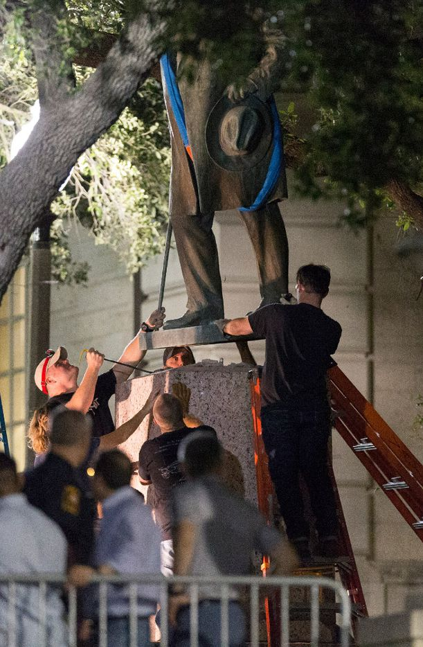 Confederate Post Master General John Reagan statue is removed from the south mall of the University of Texas at Austin early in the morning of Monday, Aug. 21, 2017.  UT president Greg Fenves ordered the removal of Confederate statues from the campus late Sunday evening.