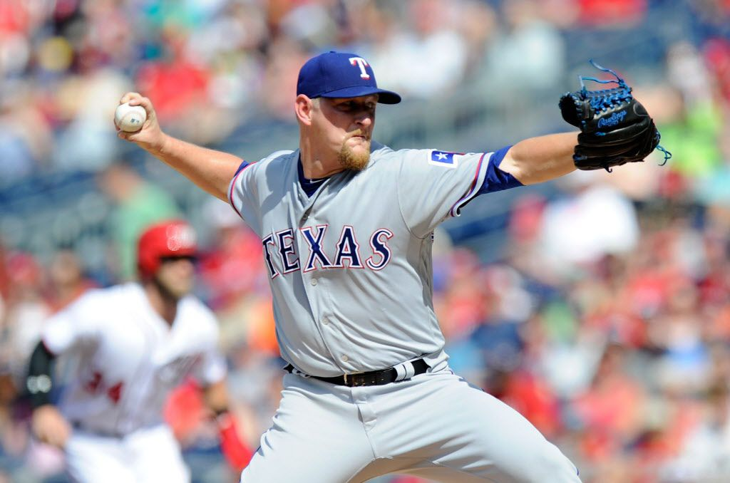 WASHINGTON, DC - JUNE 11: Austin Bibens-Dirkx #56 of the Texas Rangers pitches in the first inning against the Washington Nationals at Nationals Park on June 11, 2017 in Washington, DC.