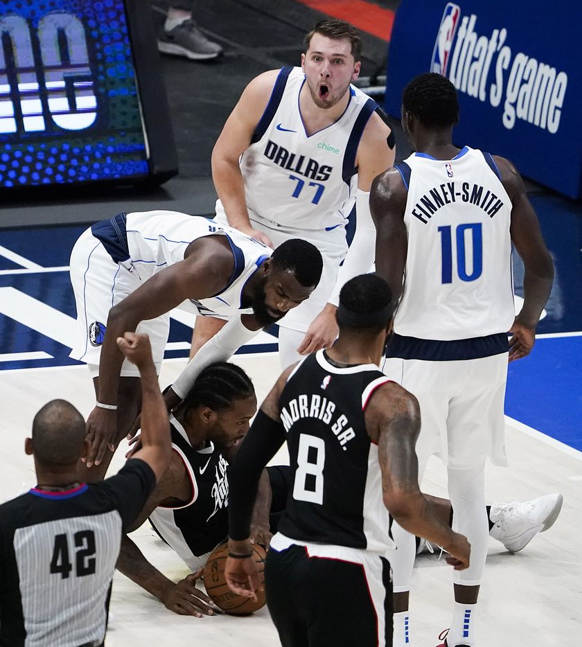 Dallas Mavericks guard Luka Doncic (77) reacts after being called for a foul against LA Clippers forward Kawhi Leonard (2) during the first quarter of an NBA playoff basketball game at American Airlines Center on Sunday, May 30, 2021, in Dallas.
