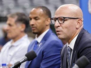 Dallas Mavericks new head coach Jason Kidd responds to questions from the media during his formal introduction alongside new general manager Nico Harrison and owner Mark Cuban (left) at the American Airlines Center, Thursday, July 15, 2021.