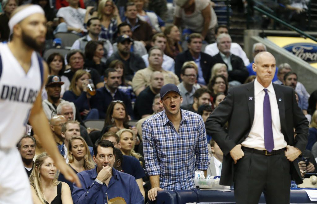 Dallas Cowboys quarterback Tony Romo watches the game behind Dallas Mavericks head coach Rick Carlisle during the second half of play at American Airlines Center in Dallas on Friday, November 13, 2015. Dallas Mavericks defeated the 90-82. (Vernon Bryant/The Dallas Morning News)
