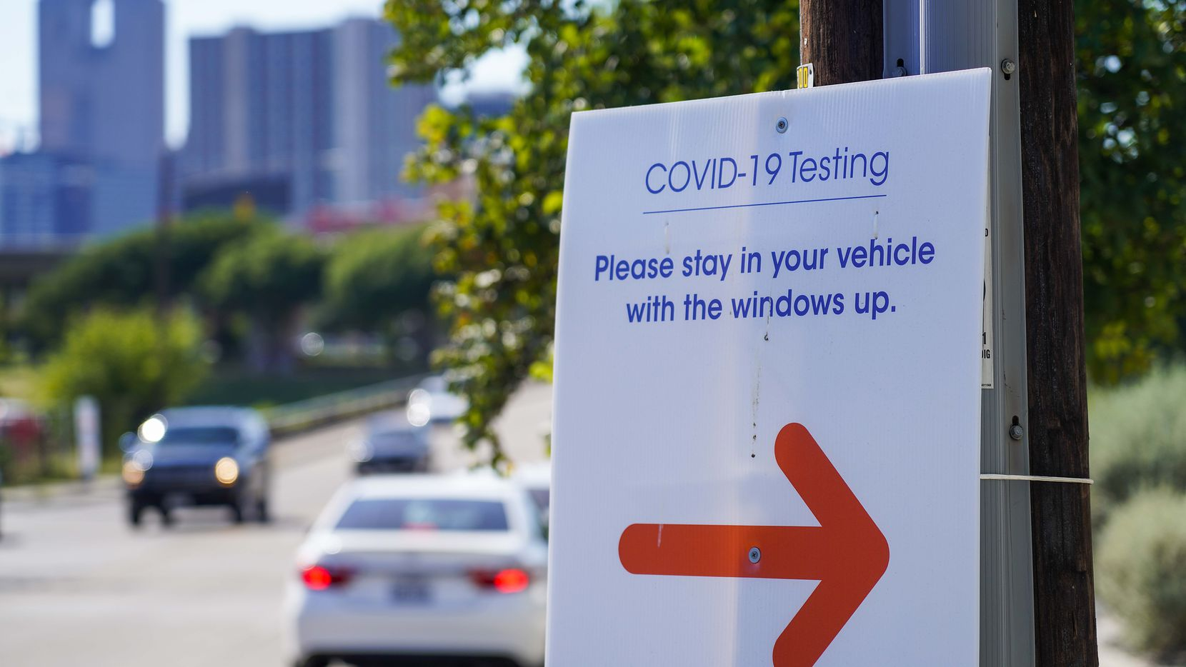 Cars line up along South Malcolm X Boulevard for a COVID-19 testing facility at CitySquare on June 17  in Dallas. The county is now offering free shelter for those with mild cases of COVID-19 who cannot isolate from family members.
