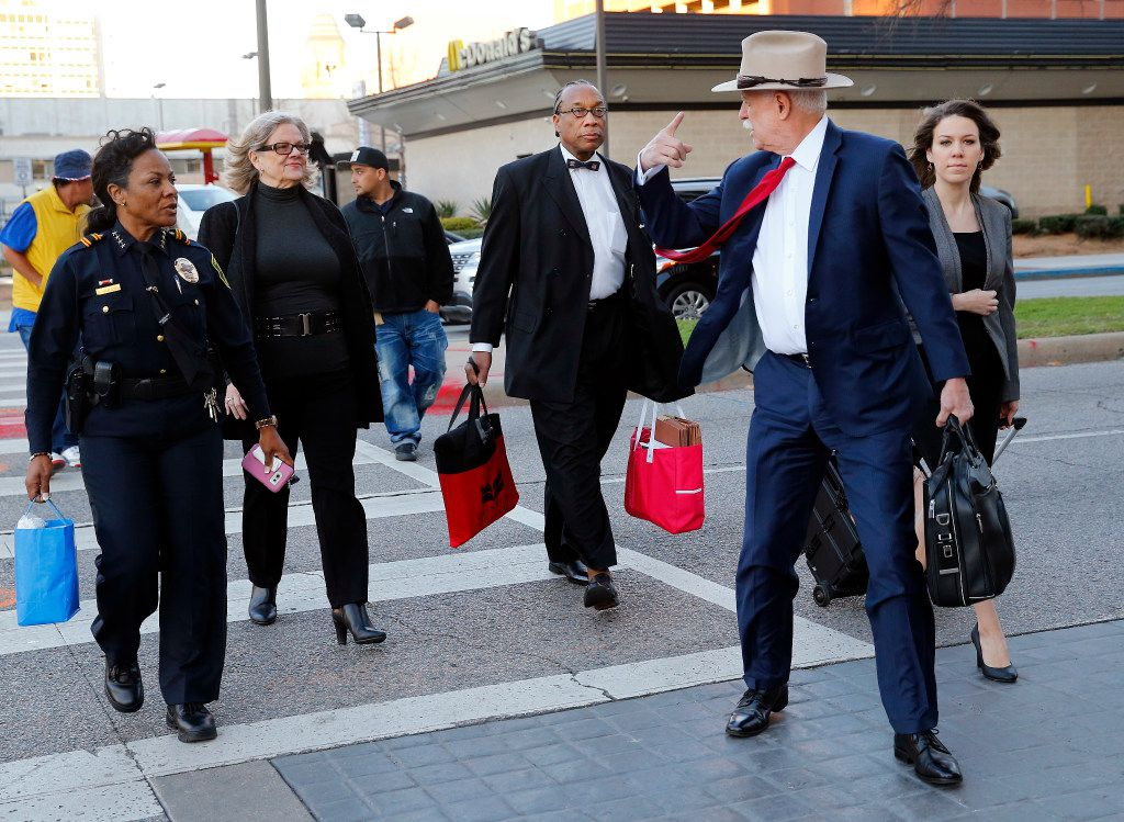 Price, with attorneys Shirley Baccus-Lobel (second from left) and Dapheny Fain's lawyer Tom Mills (second from right), arrived at the courthouse in February for the first day of the trial. (Tom Fox/Staff Photographer)