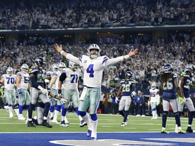 FILE — Dallas Cowboys quarterback Dak Prescott (4) celebrates after what what he thought was a fourth quarter touchdown in their NFC Wild Card win over the Seattle Seahawks at AT&T Stadium in Arlington, Texas, Saturday, January 5, 2019. Dak came up short but ran in the touchdown a couple plays later. The Cowboys won, 24-22.