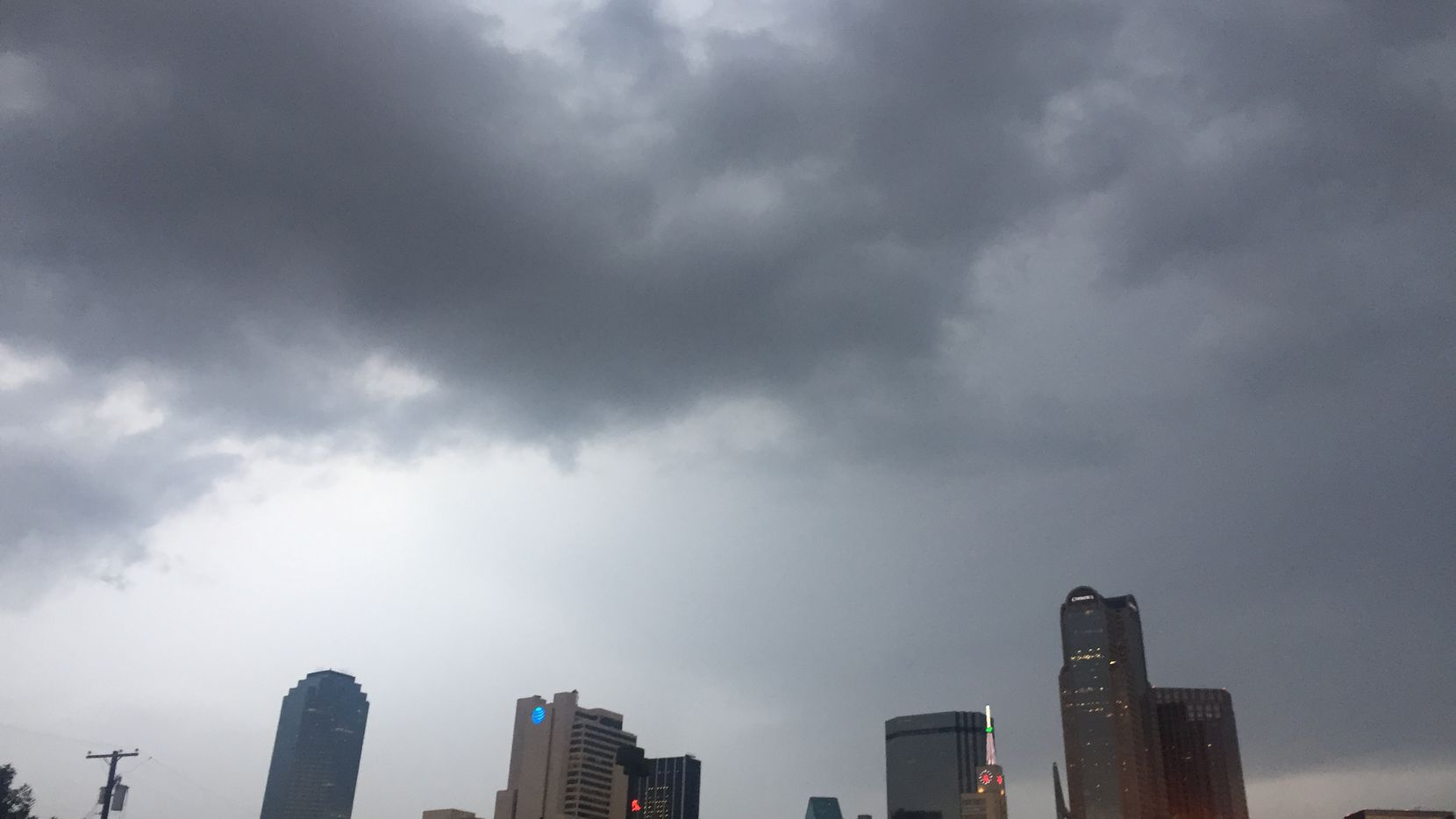Clouds gathered over the downtown Dallas skyline Friday morning.