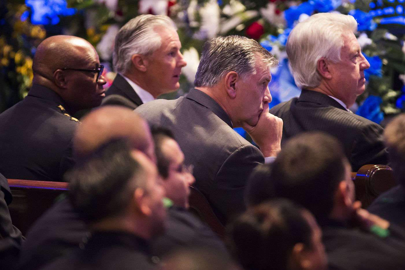 Dallas mayor Mike Rawlings (center) and police chief David Brown (left) attend funeral services for Dallas police Sr. Cpl. Lorne Ahrens at Prestonwood Baptist Churchon Wednesday, July 13, 2016, in Plano.