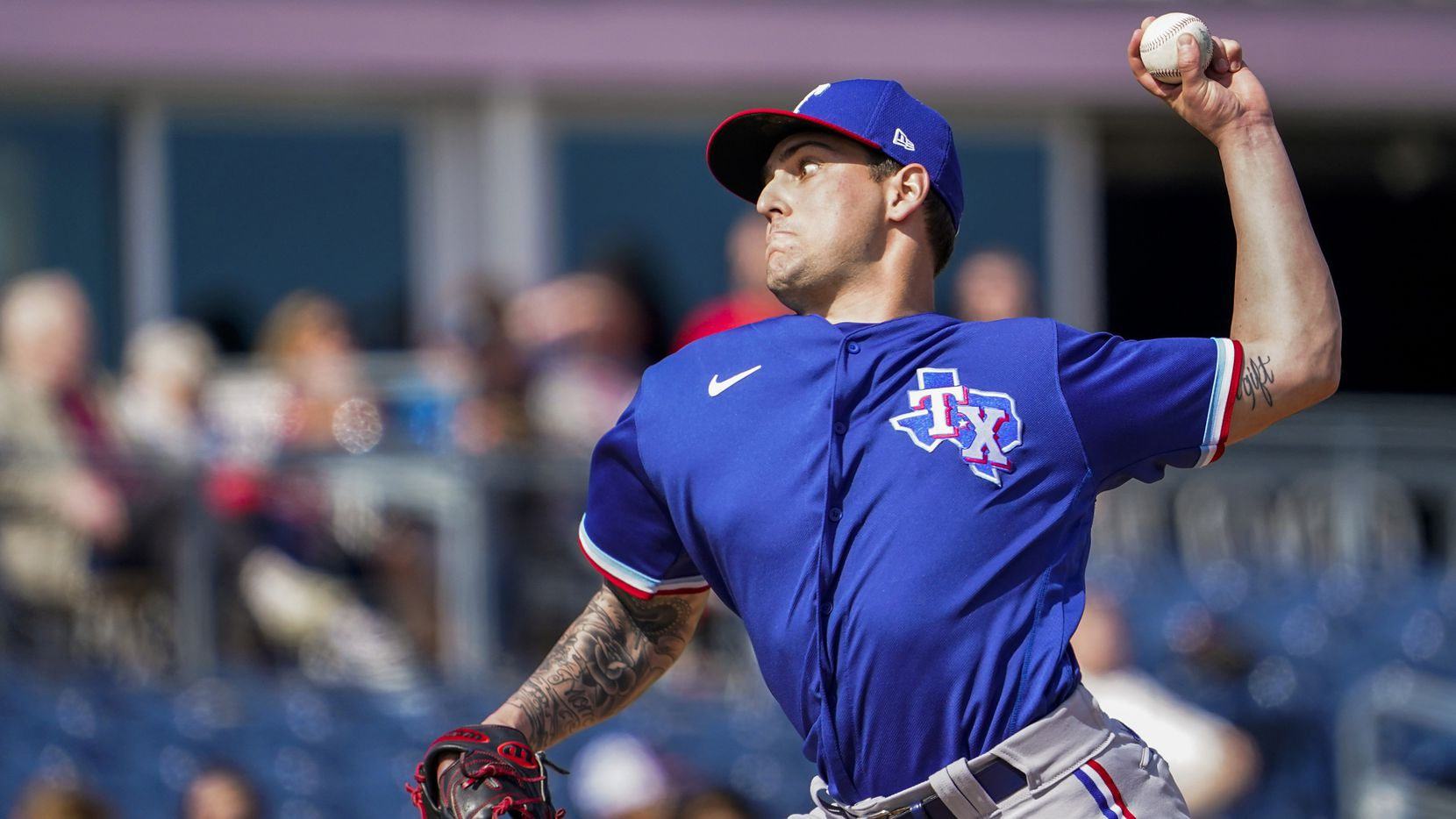 Texas Rangers pitcher Joe Palumbo pitches during the first inning of a spring training game against the Seattle Mariners at Peoria Sports Complex on Sunday, Feb. 23, 2020, in Peoria, Ariz.