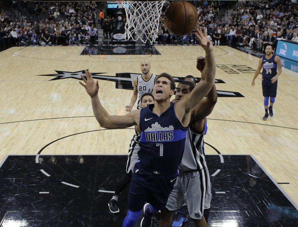Dallas Mavericks forward Dwight Powell (7) drives to the basket past San Antonio Spurs forward LaMarcus Aldridge (12) during the first half of an NBA basketball game, Monday, Nov. 27, 2017, in San Antonio. (AP Photo/Eric Gay)