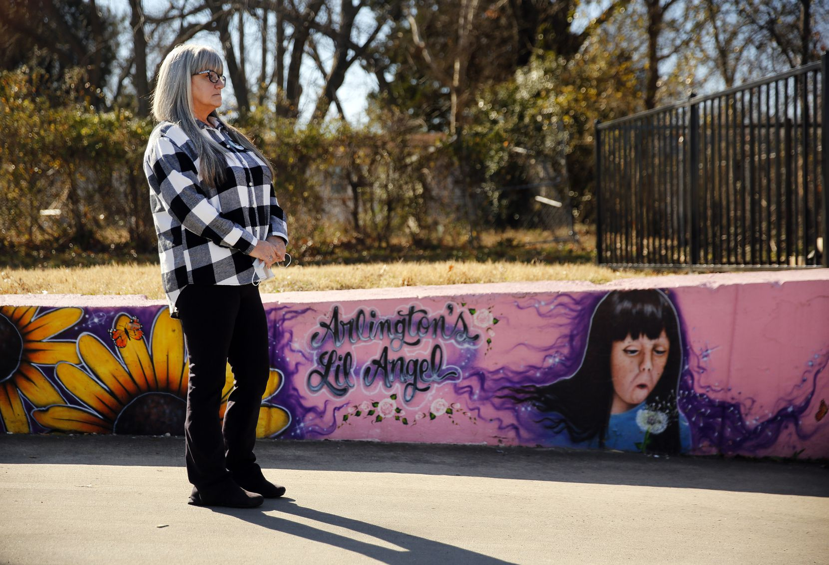 Amber Hagerman's mother Donna Williams waits her turn to speak during a press conference at her daughter's abduction site in E. Arlington, Texas, Wednesday, January 13, 2021. A mural in her honor is displayed on the parking lot wall.  On the 25th anniversary of Amber Hagerman's death, Donna spoke about her daughter and pleaded for the killer to turn themselves into the Arlington Police Department. The department held a press event to provide new details surrounding the abduction and subsequent murder of the little girl that occurred on January 13, 1996.