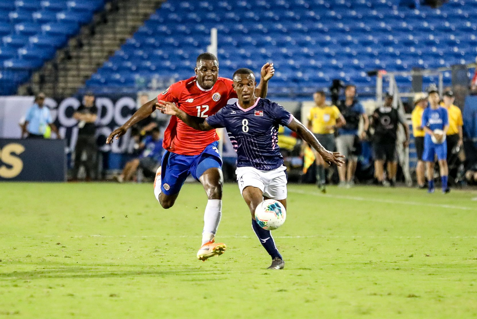Bryan Oviedo of Bermuda is chased by Costa Rica's Joel Campbell at the 2019 Gold Cup at Toyota Stadium. (6-20-19)