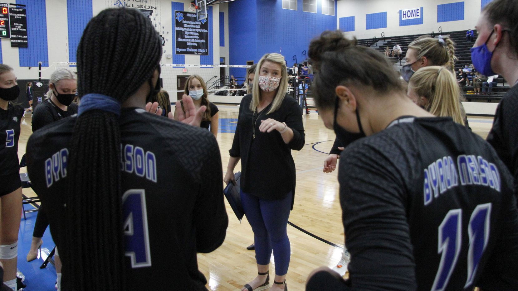 Trophy Club Byron Nelson coach Brianne Barker-Groth talks to her team during a match against Keller on September 29, 2020. (Steve Hamm/ Special Contributor)