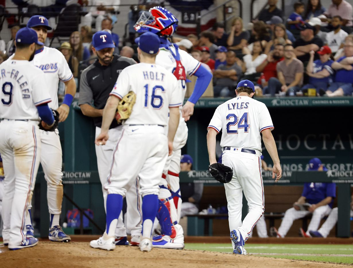 Texas Rangers starting pitcher Jordan Lyles (24) heads for the dugout after being pulled by manager Chris Woodward during the seventh inning against the Oakland Athletics at Globe Life Field in Arlington, Saturday, August 14, 2021. Lyles gave up back-to-back homers during the inning. (Tom Fox/The Dallas Morning News)