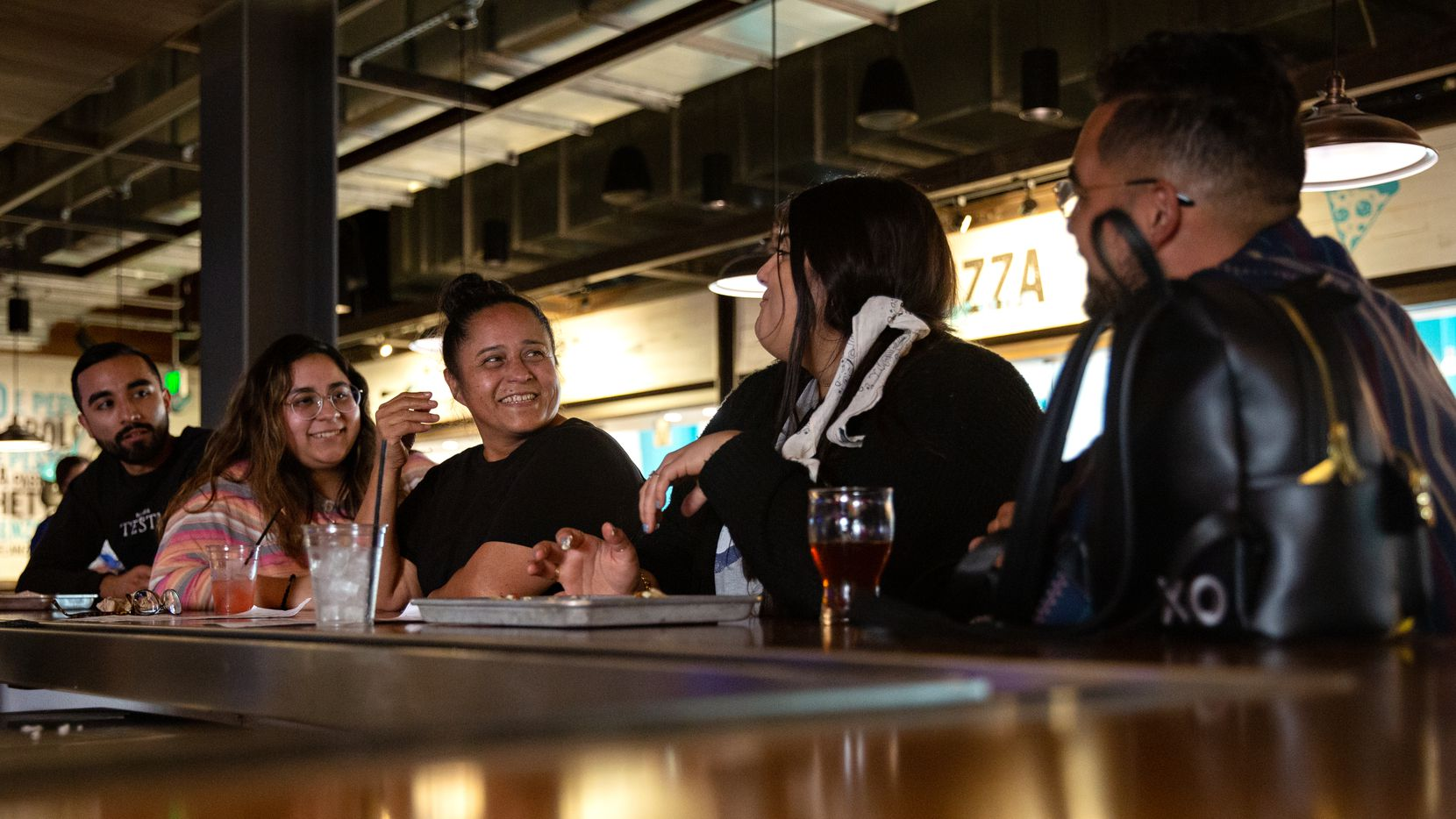 Aaron Casas (from left), Gabriella Casas, Cecilia Casas, Ivana Sarasola and Jacob Casas enjoyed drinks at Legacy Hall, part of the Legacy West complex, in Plano on Monday. All over North Texas, life is beginning to look a lot more like it did before the pandemic struck in March 2020.