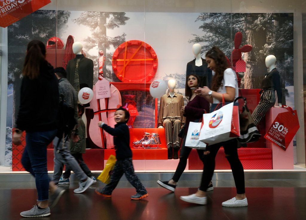 People walking in front of the H&M display in the NorthPark Center in Dallas on Nov. 23, 2018. (Nathan Hunsinger/The Dallas Morning News)