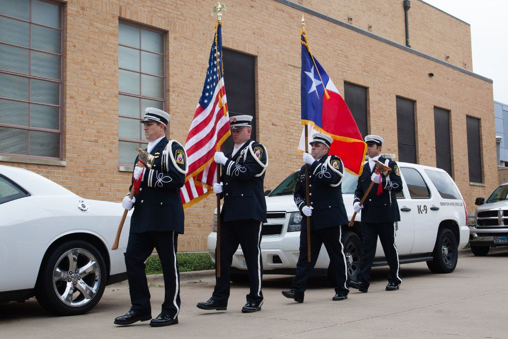 The Denton Honor Guard carries the flags out to the podium before a speech during the Public Safety Day & Emergency Preparedness Fair at the Central Fire Station in September  2016.