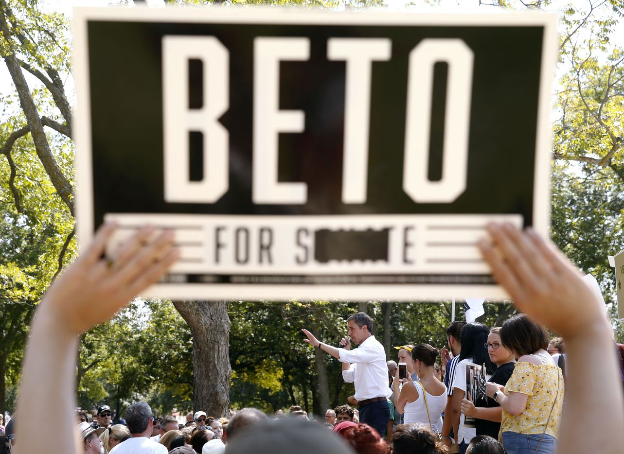 A fan holds up a sign from when Democratic Presidential candidate Beto O'Rourke previously ran for Senate and lost, during O'Rourke's campaign event at Haggard Park in Plano, Texas, on Sunday, September 15, 2019.