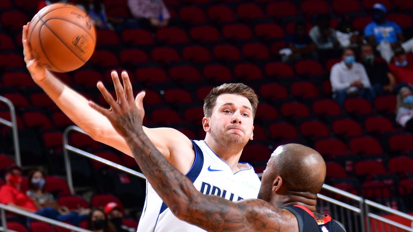 HOUSTON, TX - JANUARY 4:  Luka Doncic #77 of the Dallas Mavericks passes the ball against the Houston Rockets P.J. Tucker on January 4, 2021 at the Toyota Center in Houston, Texas.