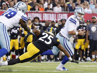 Dallas Cowboys quarterback Garrett Gilbert (3) rolls out against Pittsburgh Steelers safety Antoine Brooks Jr (25) during the first quarter of their preseason game at Tom Benson Hall of Fame Stadium in Canton, Ohio, Thursday, August 5, 2021. (Tom Fox/The Dallas Morning News)