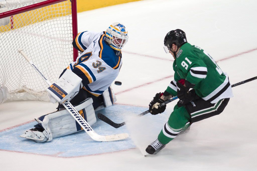 Mar 12, 2016; Dallas, TX, USA; St. Louis Blues goalie Jake Allen (34) stops a breakaway shot by Dallas Stars center Tyler Seguin (91) during the overtime period at the American Airlines Center. The Blues defeat the Stars 5-4 in overtime. Mandatory Credit: Jerome Miron-USA TODAY Sports