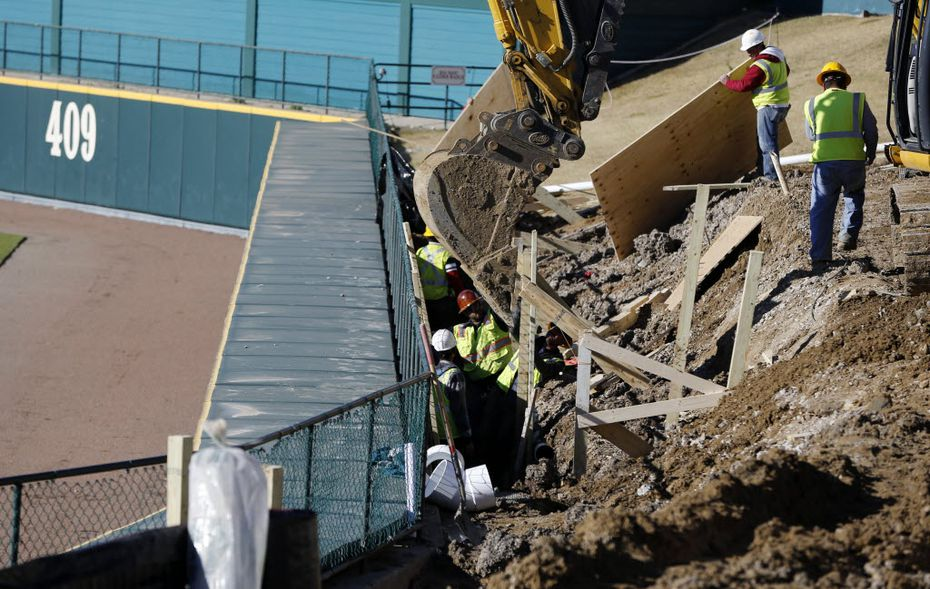 Construction crews worked on the lazy river just beyond the right field fence at Dr Pepper Ballpark in Frisco on Wednesday. (Vernon Bryant/Staff Photographer)