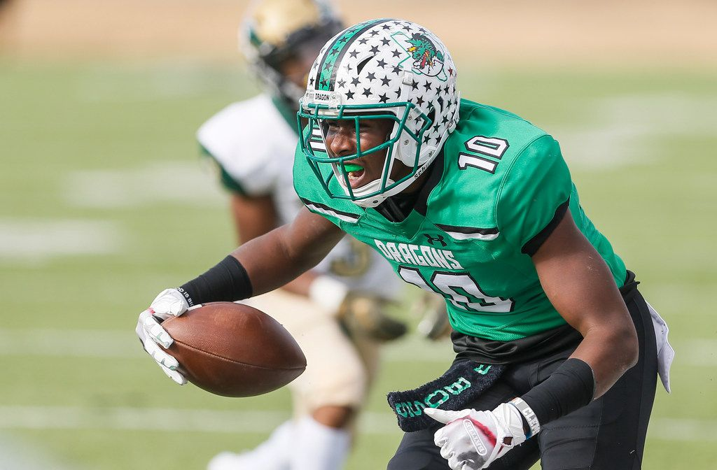 TXHSFB Southlake Carroll junior defensive back RJ Mickens (10) celebrates intercepting a pass during the first half of a Class 6A Division I area-round playoff high school football game against DeSoto at Newsom Stadium in Mansfield, Saturday, November 24, 2018. (Brandon Wade/Special Contributor)