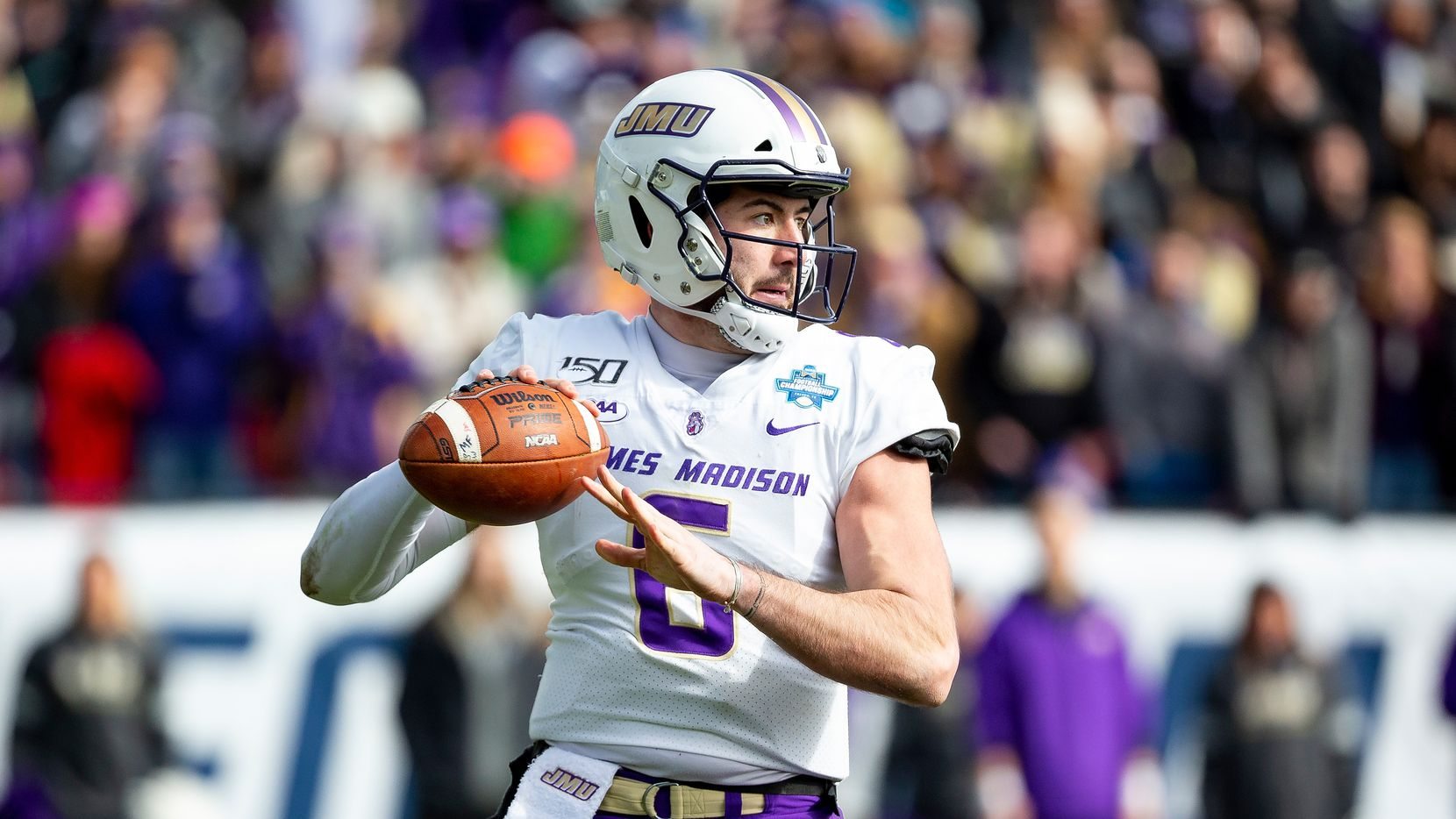 James Madison quarterback Ben DiNucci (6) looks to pass during the second half of the FCS championship NCAA college football game against North Dakota State, Saturday, Jan. 11, 2020, in Frisco, Texas. (AP Photo/Sam Hodde)
