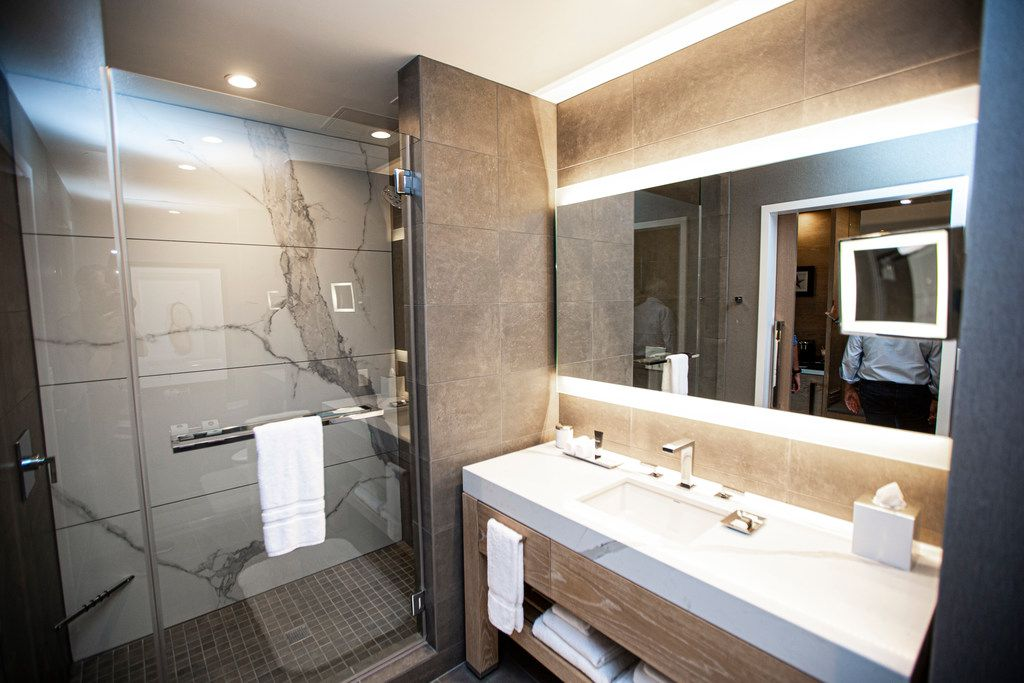 Hotel bathrooms feature marble countertops.