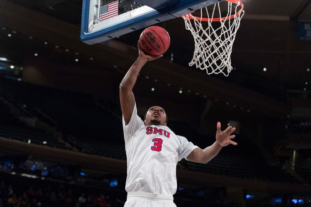 SMU guard Sterling Brown shoots during the second half of the team's NCAA college basketball game against Michigan, Friday, Nov. 18, 2016, at Madison Square Garden in New York. Michigan won 76-54. (AP Photo/Mary Altaffer)