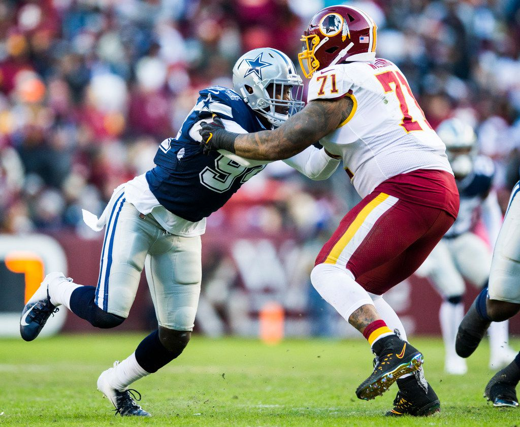 Dallas Cowboys defensive end Demarcus Lawrence (90) tackles Washington Redskins offensive tackle Trent Williams (71) during the second quarter of an NFL game between the Washington Redskins and the Dallas Cowboys on Sunday, October 21, 2018 in Landover, Maryland. (Ashley Landis/The Dallas Morning News)